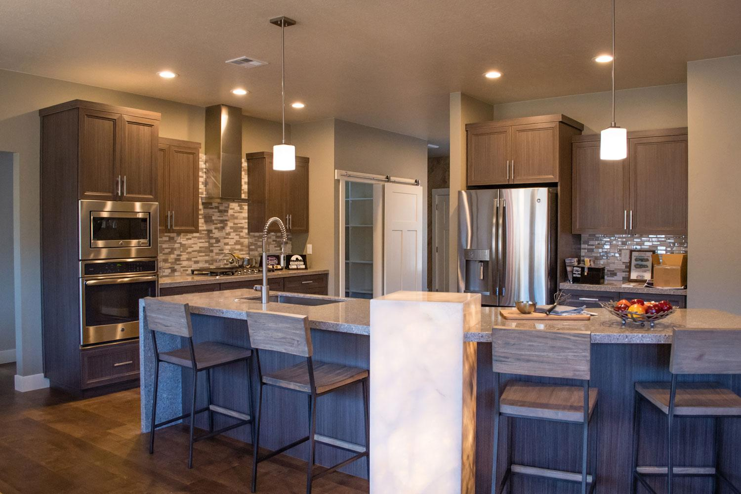 kitchen counter area for dining with four dark brown bar stools