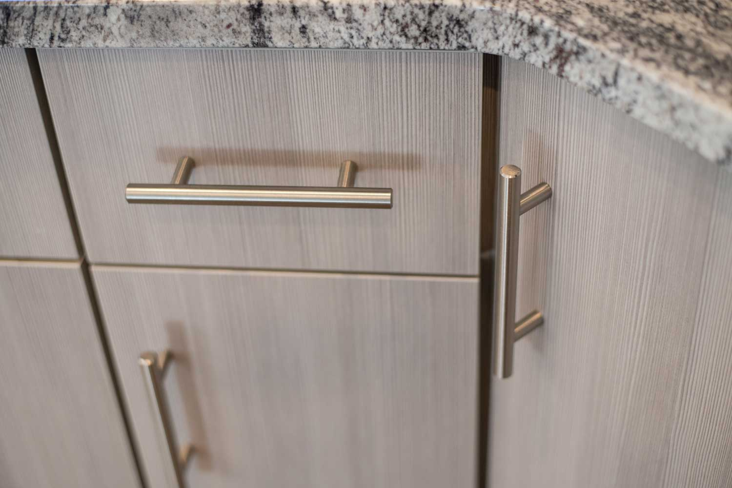 close up of silver colored cabinet handles