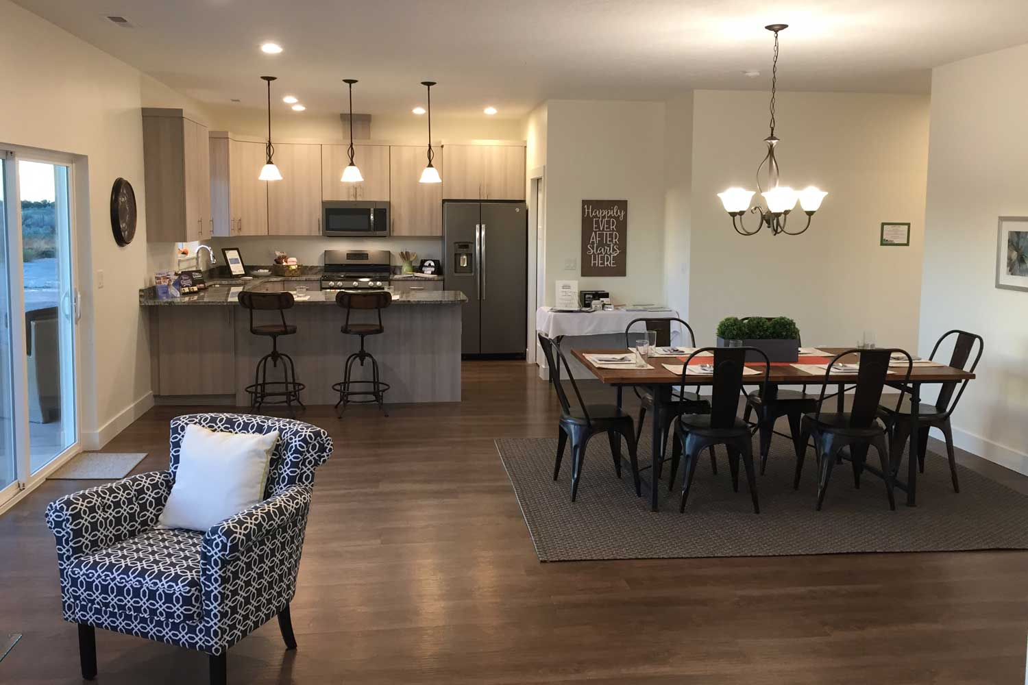 open floor plan with kitchen and dining room table